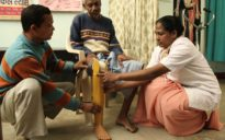 6 Sr. Ursula giving an artifical leg to a physically challenged person (2)